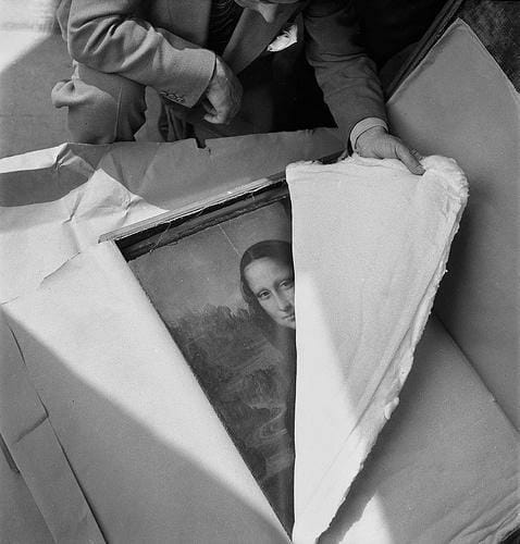 Mona Lisa being returned to it's home in the louvre in Paris after WW2